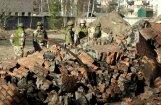 Foto: Kā karavīri Naujenē spridzināja skursteni