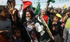 Izraēlas atbrīvotos palestīniešus svinīgi sagaida Gazas joslā