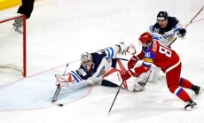 Russia forward Nikita Kucherov, Finland goalkeeper Harri Sateri