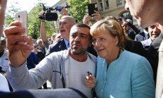 Reportāža: Kā 'Mamma Merkele' un Vācija tiek galā ar bēgļiem