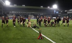 Milan players celebrate winning Super Cup