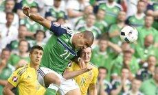 N.Ireland s forward Josh Magennis, Ukraine defender Artem Fedetskiy