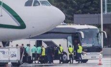 Foto: Portugāles futbolisti lielā slepenībā ierodas Rīgā