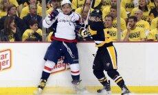 Pittsburgh Penguins Kris Letang checks Washington Capitals Alex Ovechkin