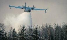 Kanādas ugunsgrēki: Fortmakmari pilsētā nedaudz uzlijis lietus; turpinās dzēšanas darbi