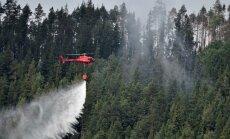 Foto: Zviedrijā mežu ugunsgrēki vairs nepaplašinās