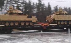 Video: Caur Latviju brauc vilciens pilns ar tankiem