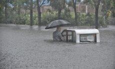 Foto: Plūdos un zemes nogruvumos Ķīnā 129 bojāgājušie