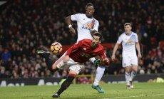 Manchester United s Henrikh Mkhitaryan scores