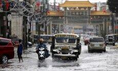 Foto: Taifūns 'Nok-ten' applūdina Filipīnu galvaspilsētu Manilu