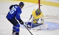 Europe forward Thomas Vanek (Austria) scores Sweden Henrik Lundqvist