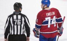 Montreal Canadiens defender Alexei Emelin with linesman Michel Cormier