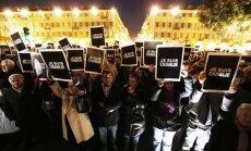 Tūkstošiem cilvēku visā Eiropā piemin apšaudē Parīzē nogalinātos