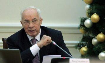 Ukrainas premjers aizstāv vienošanos ar Krieviju; opozīcija sauc par nodevību