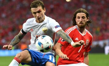 Russia Pavel Mamaev against Wales Joe Allen