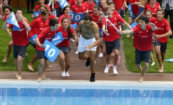 Rafael Nadal of Spain jumps into a swimming pool