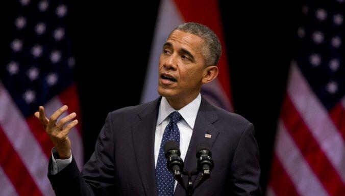 Барак Обама и его супруга за год заработали почти полмиллиона долларов