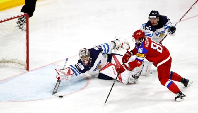 Russia forward Nikita Kucherov, Finland goalkeeper Harri Sateri