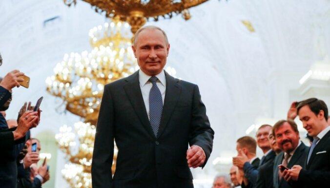 Vācija un Francija aicina Putinu spēlēt konstruktīvu lomu pasaulē