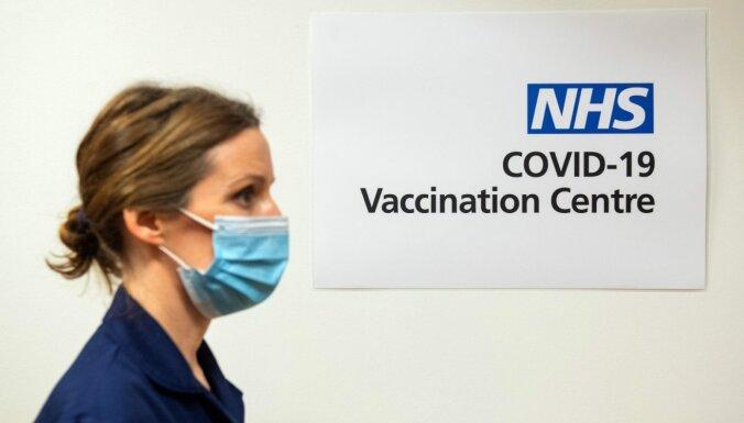 Covid-19: Lielbritānija sāk vakcinēšanu, Izraēlā nakts komandantstunda
