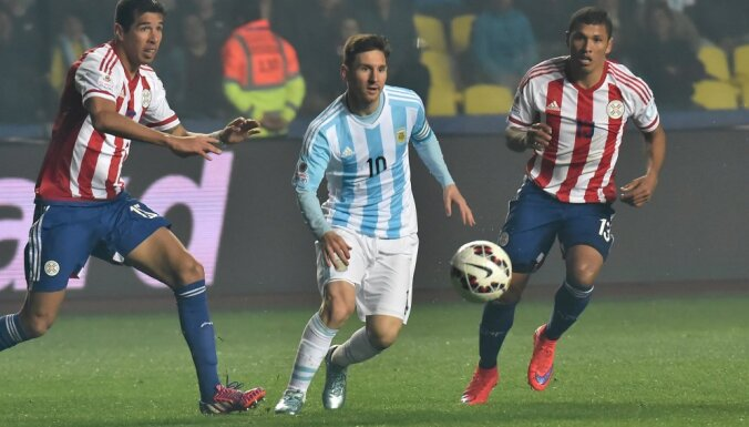 Argentina forward Lionel Messi with Paraguay