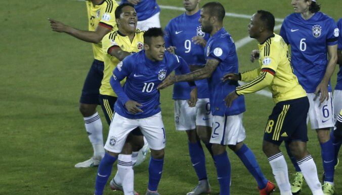 Colombia s Carlos Bacca, second left, pushes Brazil s Neymar,