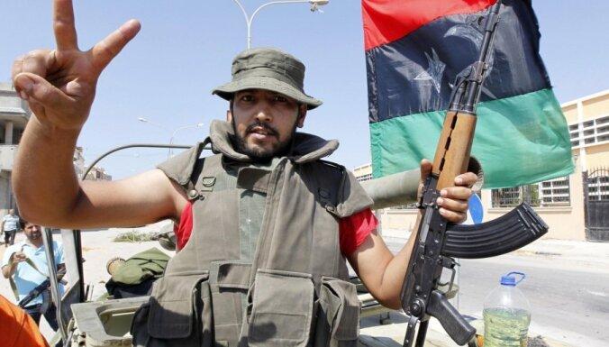 Lībijā tiesā 20 Ukrainas pilsoņus, kas apsūdzēti kā Kadafi režīma algotņi