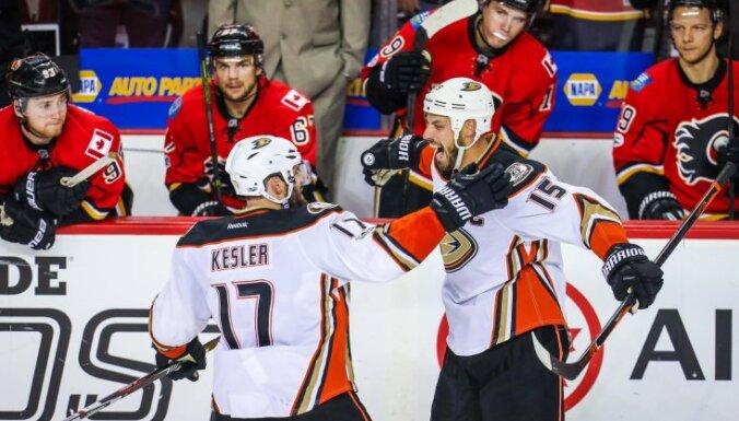 Anaheim Ducks Ryan Getzlaf and Ryan Kesler in front of Calgary Flames bench