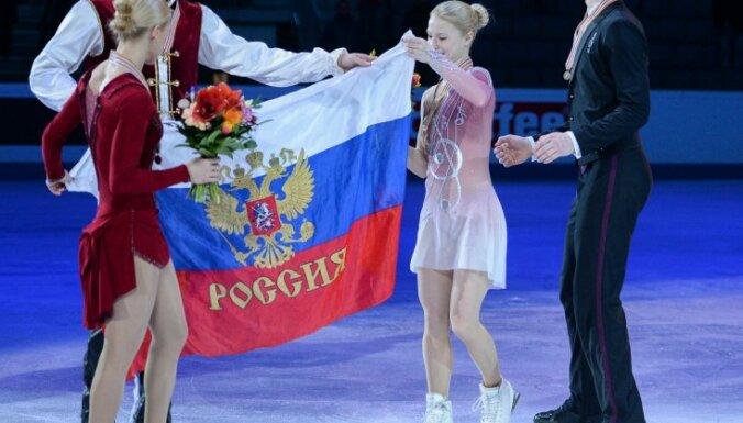 Tatyana Volosozhar and Maksim Trankov (gold medals), Russia s Yevgeniya Tarasova and Vladimir Morozov