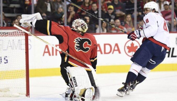 Calgary Flames goalie Karri Ramo vs Washington Capitals Alex Ovechkin