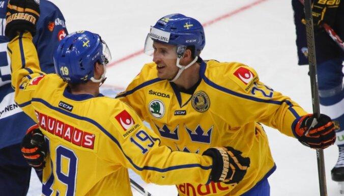 Sweden Patrik Zackrisson, left, Alexander Bergstrom