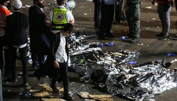 Foto: Izraēlā reliģiskos svētkos drūzmā gājuši bojā vairāki desmiti cilvēku