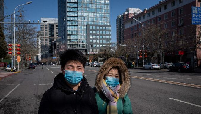 Ķīnā otro dienu visi jaunie 'Covid-19' gadījumi ir 'importēti'