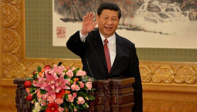 Ķīnas parlaments vienbalsīgi pārvēlējis Sji Dzjiņpinu prezidenta amatā