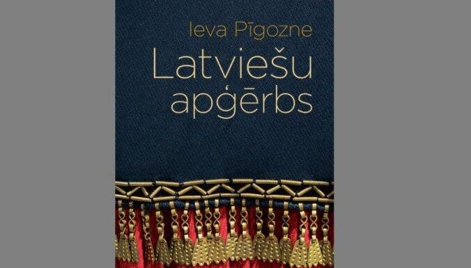 Izdota kultūrvēsturnieces Ievas Pīgoznes grāmata 'Latviešu apģērbs'