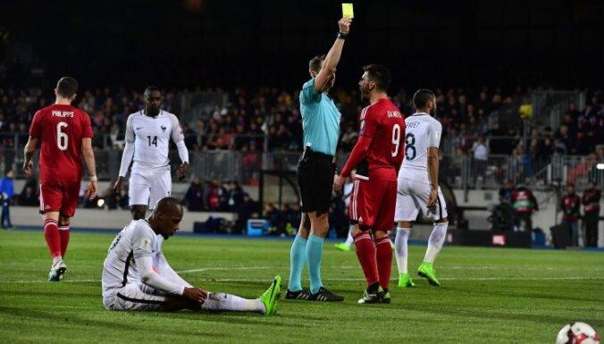 Luxembourg Daniel Da Mota receives yellow card from Andris Treimanis