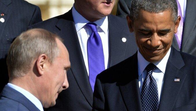 Популярность России и Путина в мире ниже, чем у США и Обамы