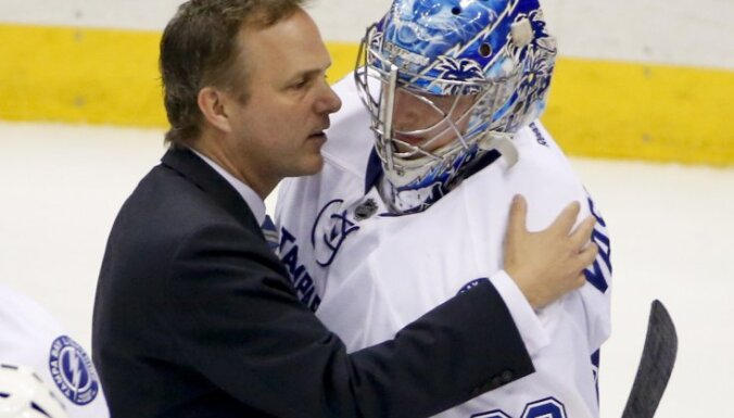 Tampa Bay Lightning coach Jon Cooper with goalie Andrei Vasilevskiy