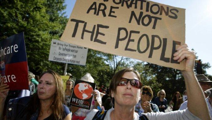 Visā pasaulē aicina protestēt pret alkatīgajiem baņķieriem, finansistiem un politiķiem