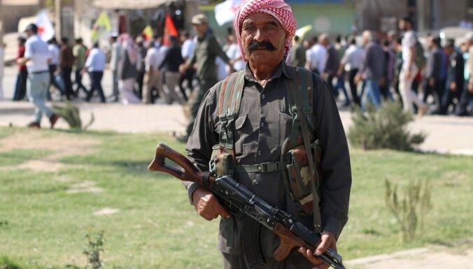 Курдские силы отходят из приграничной зоны Сирии