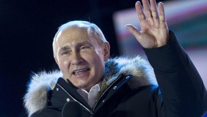 Путин с 76% голосов официально объявлен победителем выборов президента России