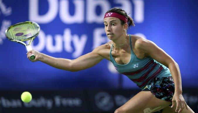 Anastasija Sevastova returns ball to Wozniacki