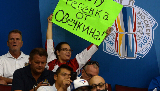 fans female Ovechkins in the game Russia - Finland