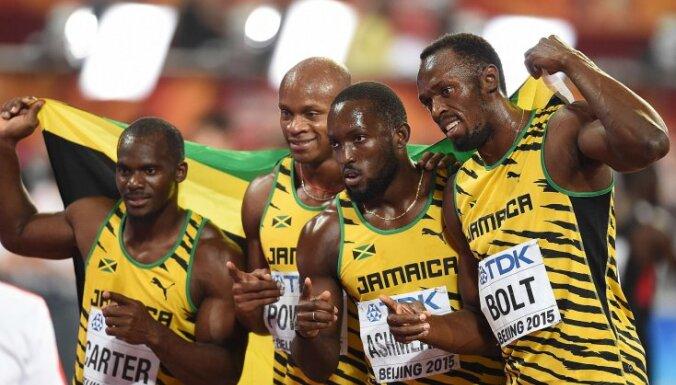 The Jamaican relay team (L-R) Nesta Carter, Asafa Powell, Nickel Ashmeade and Usain Bolt