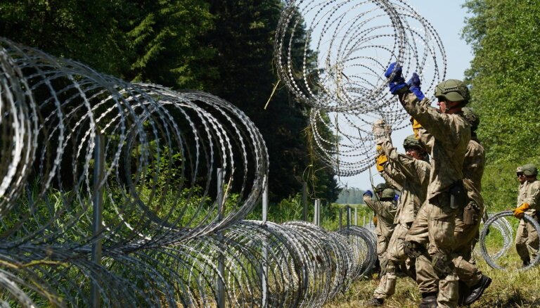 "Мигранты в Литве: Лукашенко, ""колючка"" на границе и проблемы Вильнюса"