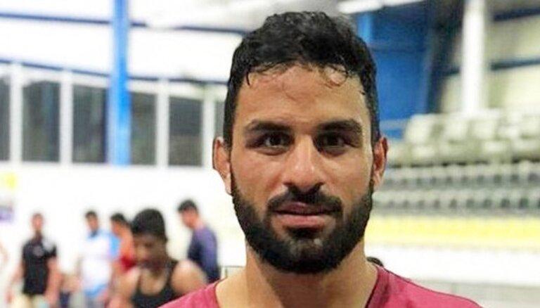 SOK nosoda nāves soda izpildi Irānā pret cīkstoni Afkari