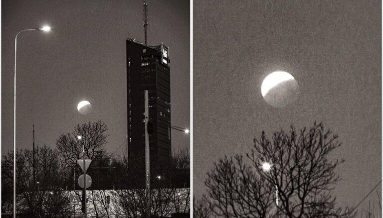 Foto: Aculiecinieks fiksē Mēness aptumsumu Rīgā