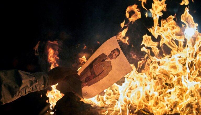 ФОТО. Протесты в Каталонии: в огонь бросают портреты короля Испании