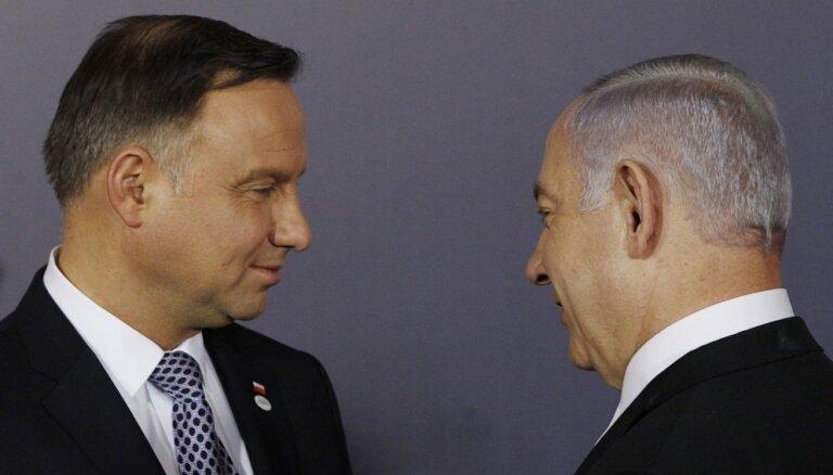 Izraēlai pirmajai jāsper solis, lai atrisinātu krīzi ar Poliju, uzskata Duda