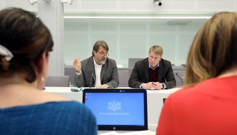 Parlamentārie izmeklētāji cenšas noskaidrot OIK regulējuma autorus